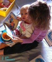 Older Sibling Reading to Toddler