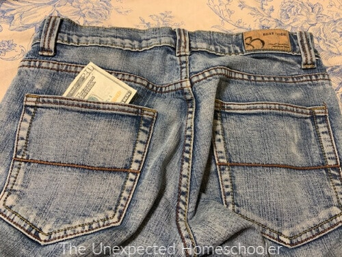 Twenty dollar bill in pocket of jeans